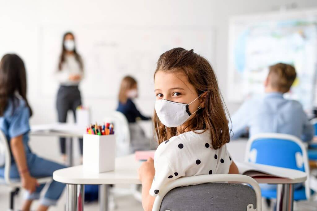 child-with-face-mask-back-at-school-after-covid-19